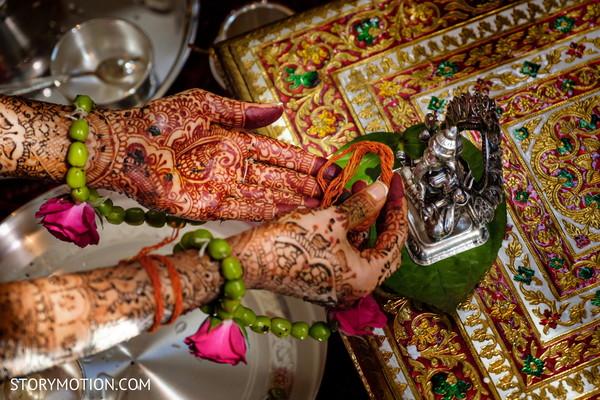 Closeup capture of maharani making offerings to Ganesha god.