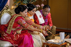 Indian bridal making offerings to sacred fire.