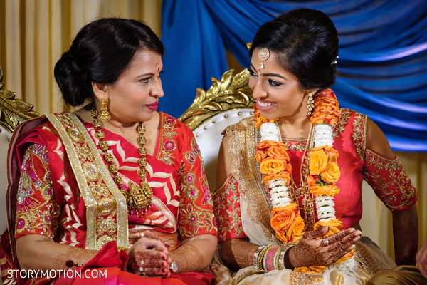 Lovely Indian bride with her mother's photo.