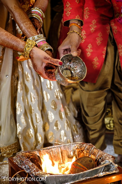 Maharani pouring oil to sacred fire.