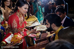 Indian groom getting special flat bread at sangeet.