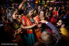 Indian bridesmaids and groom at sangeet celebration.
