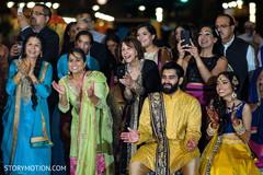 Indian bride and groom enjoying their sangeet celebration.