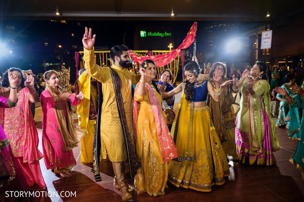 Indian lovebirds at their sangeet dance.