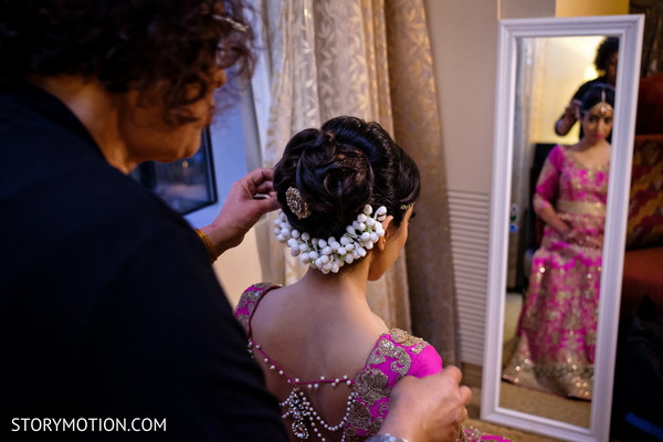 See this lovely Indian bride getting her hair done.