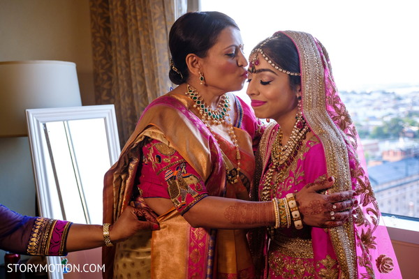Sweet capture of Indian bride with mother.