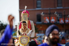 Indian groom with special guest riding baraat white horse.