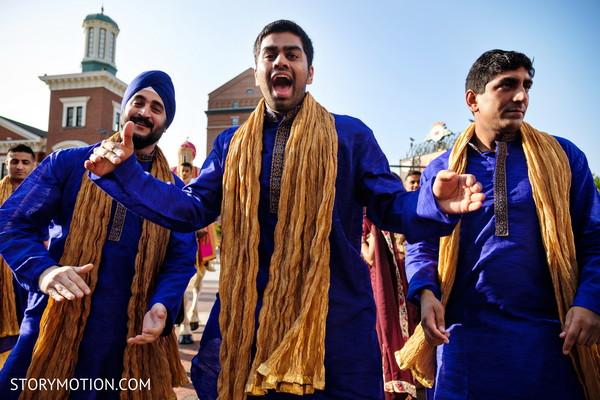 Indian groomsmen during baraat celebration