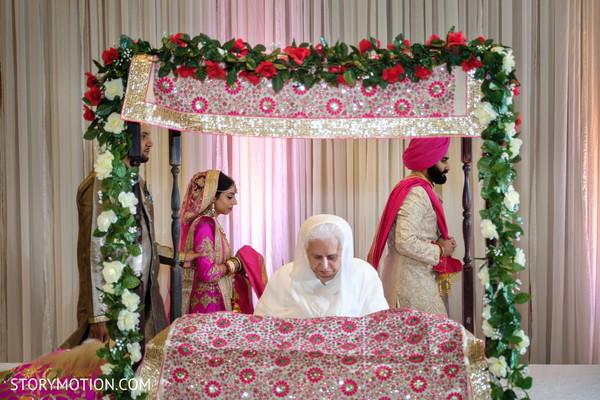 Incredible Indian wedding sikhism ceremony Granthi Bandhanam ritual.