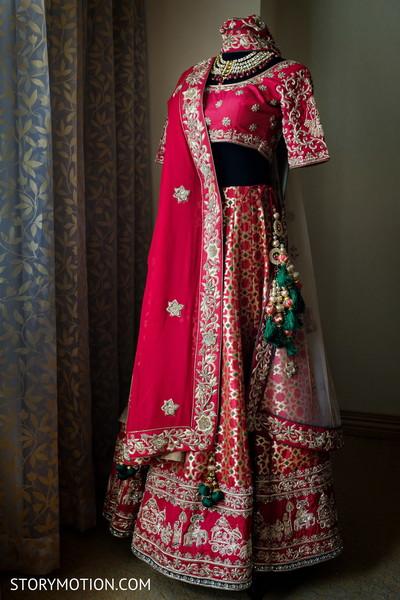 Stunning Indian bridal ceremony red lehenga set.