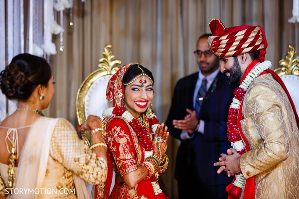 Indian bride and groom at their  garland exchange ritual.