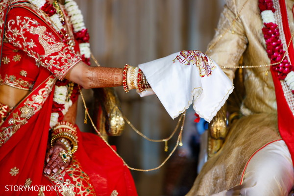 See this Indian wedding couple during their wedding rituals.