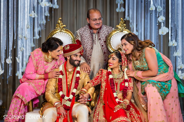 Adorable Indian couple posing with family