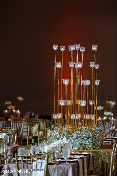 Stunning Indian wedding reception centerpiece table decor.