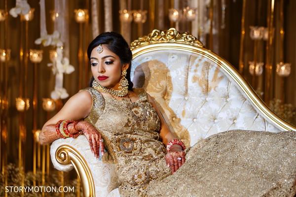 Ravishing Indian bride posing with reception anarkali.