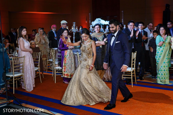 Impressive Indian couple's entrance to wedding reception.