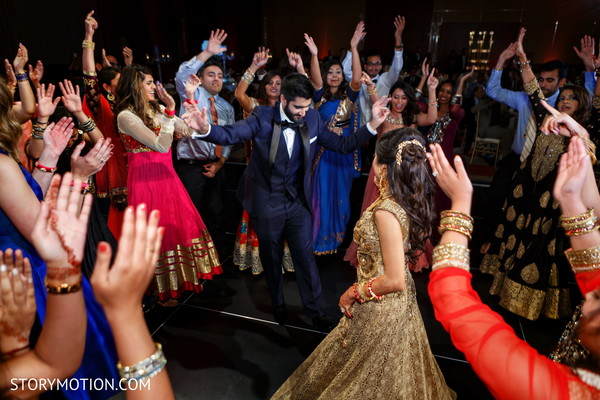 Indian lovebirds dancing at their reception party.