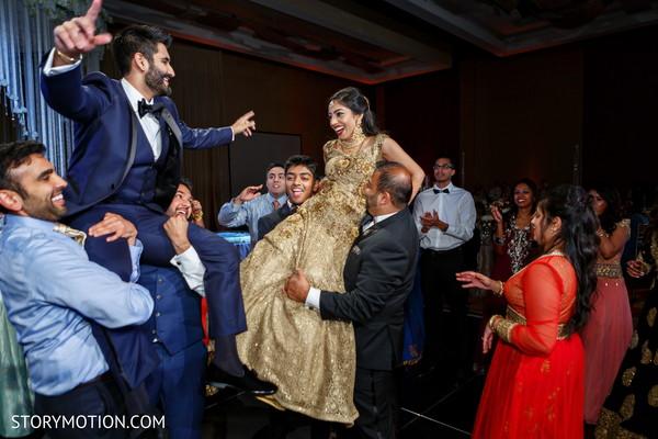 Upbeat Indian guest, bride and groom celebration.