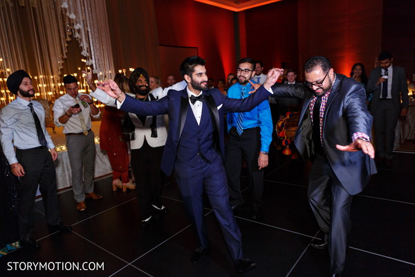 Indian groomsmen during reception celebration