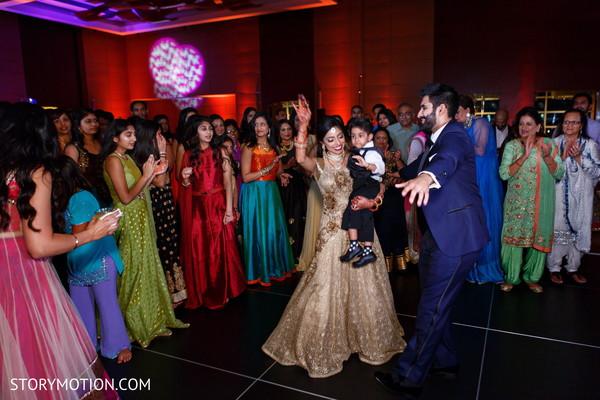 Adorable indian bride dancing capture.