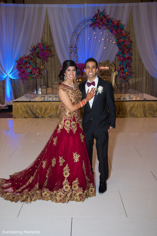 Indian love birds posing for reception photo.