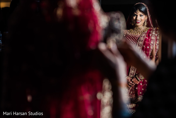 Dazzling Indian bride posing for pictures