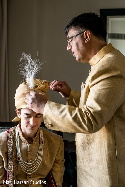 Indian groom being assisted by special family guest