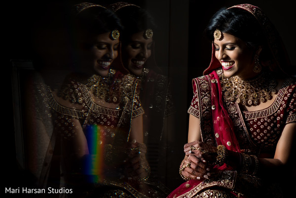 Gorgeous Indian bride smiling during the photo shoot