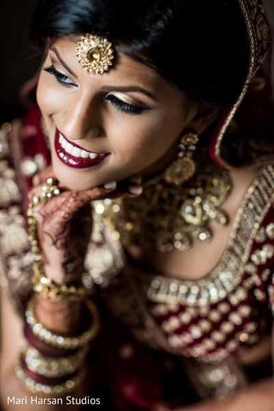 Glamorous Indian bride posing for pictures