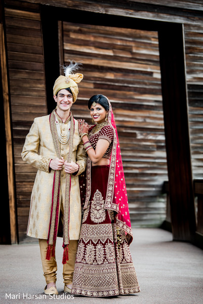 Indian bride and groom posing prior to the ceremony