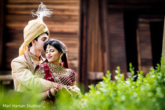 Indian bride and groom taking pictures outdoors