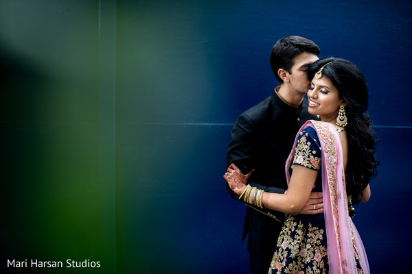 Indian couple posing for pictures