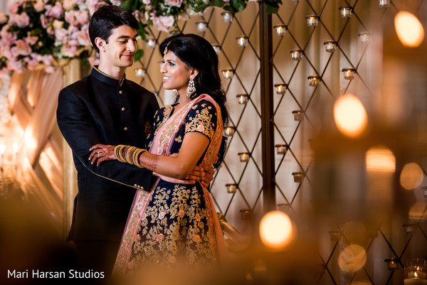 Indian bride and groom by the floral arrangements