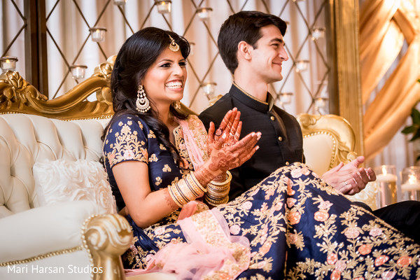 Indian couple smiling during speeches