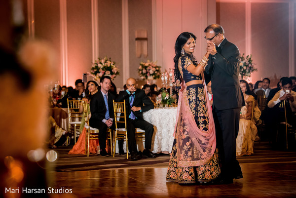 Indian bride dancing with special family guest