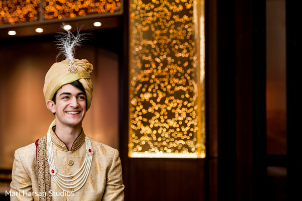 Indian groom smiling prior to the ceremony
