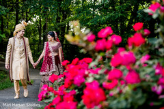 Indian groom and bride walking by the park