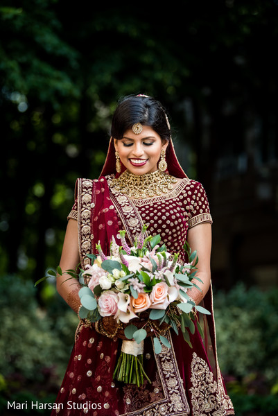 Maharani holding the amazing floral arrangement