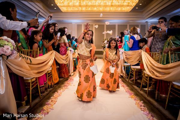 Adorable flower girls entering indian wedding