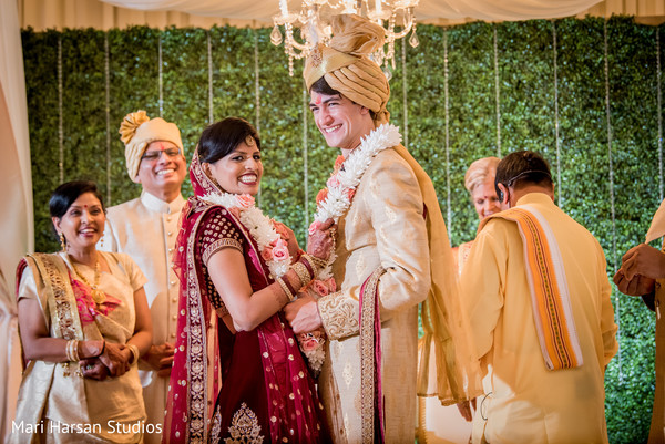 Adorable indian couple exchanging garlands