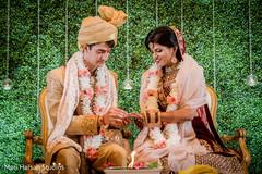 Indian bride receiving her wedding ring