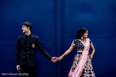 Raja and Maharani holding hands