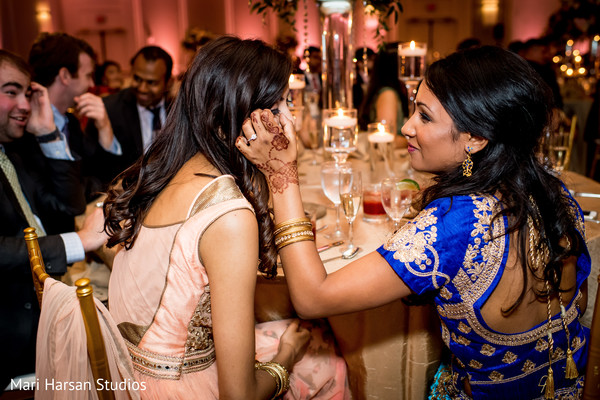 Guests helping each other during the reception
