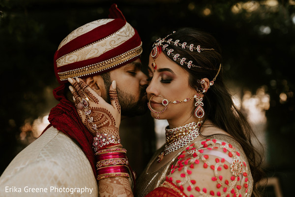 Adorable indian groom kissing the bride