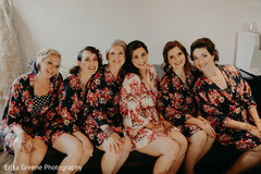 Adorable indian bride getting ready with bridesmaids