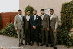 Indian groom posing with groomsmen