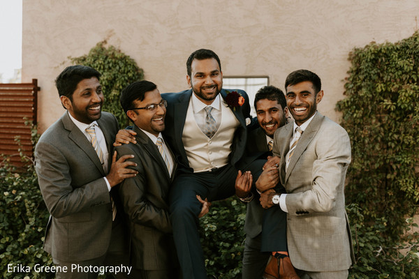 Indian groom having fun with groomsmen