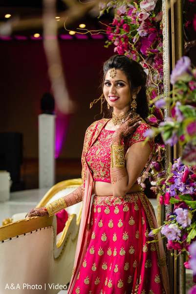 Indian bride posing by the floral arrangements