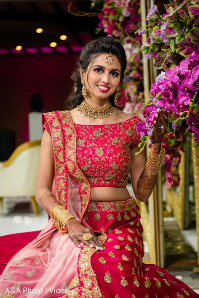 See this gorgeous Indian bride by the flowers