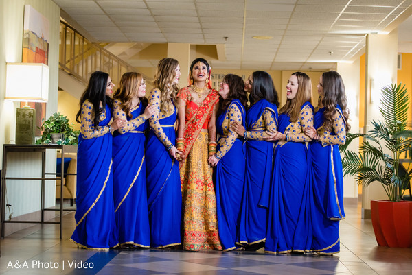 Lovely bridesmaids posing with the Indian bride